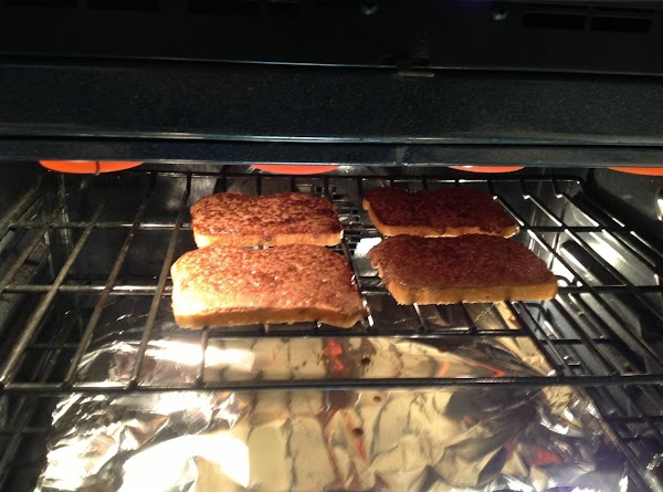 By keeping a very close watch to prevent burning, cook cinnamon toast until it...