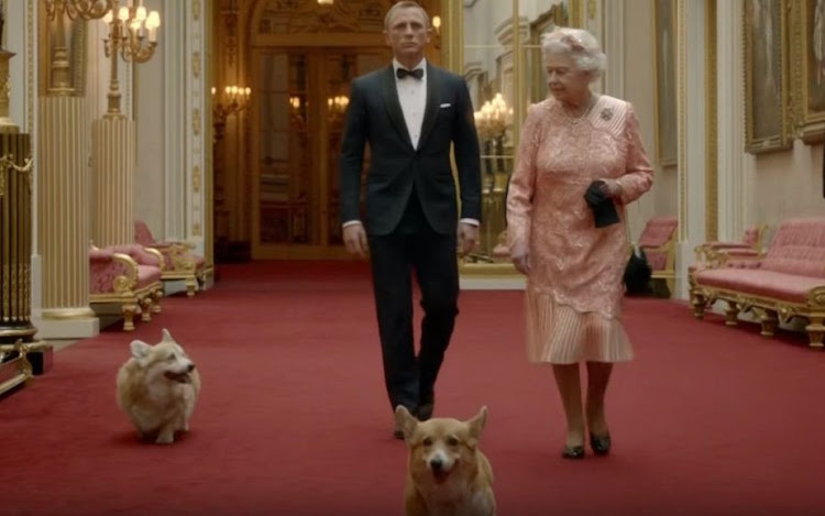 Daniel Craig and Queen Elizabeth II with her corgis Willow and Holly.