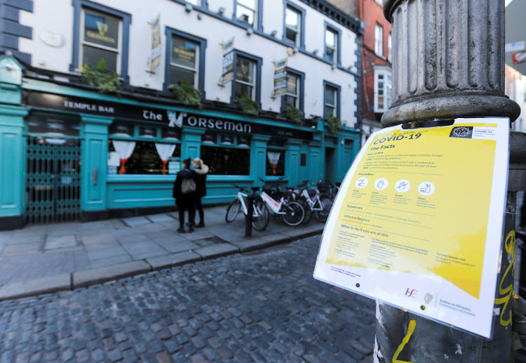 A notice about coronavirus is pictured as pub doors are locked in the Temple Bar area, as bars across Ireland close voluntarily to curb the spread of coronavirus, in Dublin, Ireland, March 15, 2020.