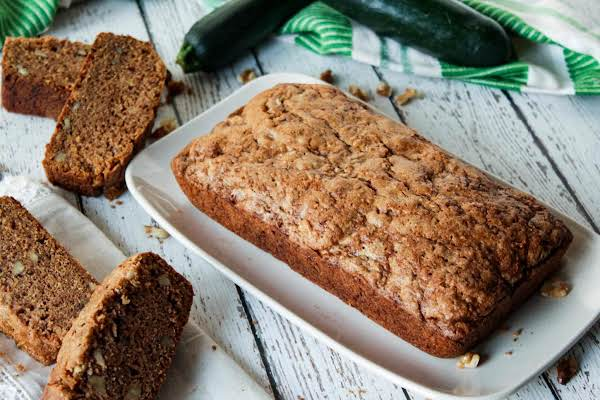 Loaf Of Baked Zucchini Bread With 4 Slices.