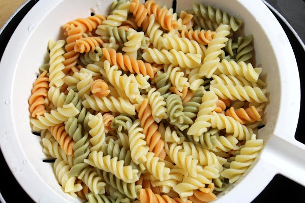 Bring a large pot of lightly salted water to a boil. Add pasta, and...
