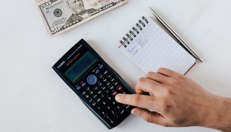 using a calculator to calculate finances before a move