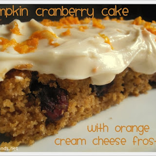 Pumpkin Cranberry Cake with Orange Cream Cheese Frosting.