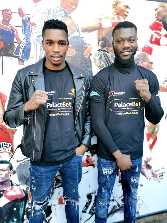 Fighters Thulani Mbenge and Jabulani Makhense came face-to-face yesterday after signing on the ditted line for theirs howdown to take place at Emperors palace on June 23.