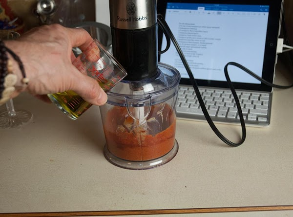 Set the blender on high, and slowly drizzle in the oil until the mixture...