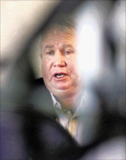 DETAINED: Roy Bennett, a senior member of the MDC, is held in custody in Mutare since his arrest on Friday. 13/02/09. Pic. Denis Farrell. © AP.