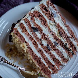 Chocolate Cake with Plums, Walnuts and Sour Cream Frosting.