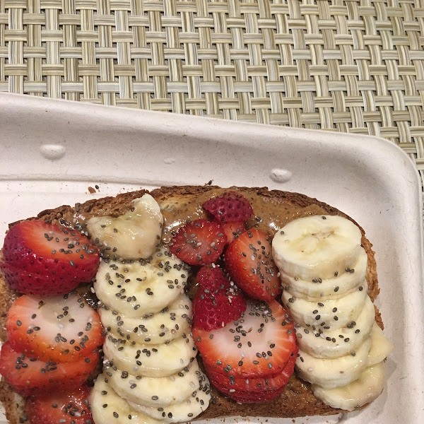 GF almond butter toast with bananas, strawberries, agave and chia seeds!