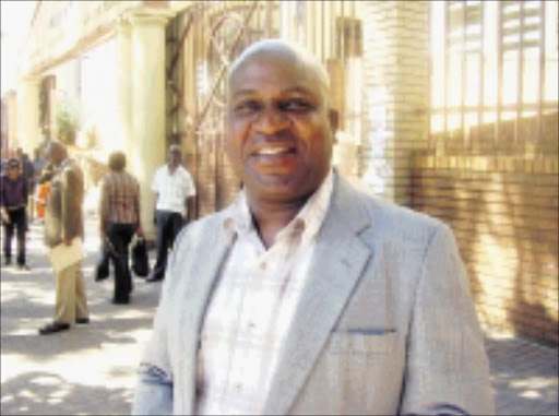 TROUBLE LOOM: Former teacher Boiki Kenneth Ngobeni outside court in May when murder charges against him and four others were withdrawn. Pic. Riot Hlatshwayo. 29/08/2008. © Sowetan.