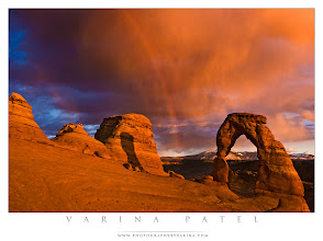Photo: My Own Worst Critic - First I'll bash my work. Then it's your turn.  Delicate Arch - Arches National Park, Utah  Thanks to all those who joined us for our Open Critique Hangout yesterday! I think it went very well. It's always tough to ask for a public critique - and I want to send special thanks to those who put themselves out there.  I think that image critique is an incredible tool for learning - and I'm a firm believer in being your own worst critic. And I'm putting my money where my mouth is by offering my own image for public critique. And I'll start things off by providing a scathing critique of my own work to get you started. :) Think of this as a learning opportunity - sometimes we learn as much by critiquing other people's work as we do by hearing critiques of our own work.  So - +Jay Patel always tells me he loves this shot... but I rarely share it because I don't think I did a very good job with it. I was fighting time - trying to capture that gorgeous rainbow before it faded. And then there's the processing... which leaves something to be desired.  Let's start with composition. There's too much going on here. Rather than making Delicate Arch the clear subject of the photo, I included three bumpy things on the left - and they are fighting for attention alongside the storm clouds, the rainbow, the horizon line in the distance, and the arch itself. A much tighter crop would improve the image substantially - how about just the arch and the first bump on the left? I'd lose the intense blue color over there... but I actually think that's pretty distracting, too. It's the only area in the image that isn't glowing orange - which means it grabs your attention. Better to allow the arch and the rainbow to do all the grabbing. Too much grabbiness can ruin a perfectly good photo.  And while we're on the subject of the intense blue... let's talk about processing. Does that blue color feel natural to you? It sure doesn't feel right to me. And that means that this image fails to meet my own standards for inclusion in my portfolio. (Please note: I don't have ANY problem with other people's color choices in their own artwork. This is a personal preference for my own work... most of the time.) The solution? Well - the color balance for the areas in bright sun are about right - but that area isn't lit by the sun, so the color temperature is different there. I need to choose the correct color balance for that area, and blend for a more realistic scene.  What else? Ah yes - the brightest areas in the shot are the storm cloud in the upper right and the glowing sandstone on the lower left, so that's where the viewers attention goes first. The arch feels like an afterthought. That's a pretty major mistake in my opinion. If the image is about the arch - and it really should be - then I need to make sure the arch is where your eye lands as soon as you look at the image.  So - there it is. The location was breathtaking, the sky couldn't have been more incredible, and the light was to die for... but I didn't do the scene justice with this image.  All right - now it's your turn. This is meant to be a learning process... I want to show how incredibly useful critique can be... and how important it is to be your own worst critic. So, please feel free to tear this image to pieces. I plan to take your suggestions - and my own advice to myself - and redo the post-processing for the shot. Then, I'll post the results.  And feel free to share this post. I always appreciate your shares and comments.  Now, I'll just go put on my crash helmet. ;)