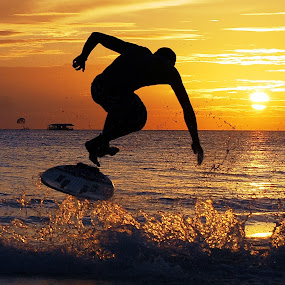 the skimboarder by Dan Baciu - Sports & Fitness Watersports ( skimboard, wakeboardng, watrsports, pwcsilhouettemotion, sports, wather, extrea, island, watersport, surfing, shadow, wake, wakes, on, phillipines, movng, surf, skimboarder, water, wakeboard, boarding, sea, sport, skimboarding, the, board, beac, great, sunrse, boracay, sunset, sunrise, extream, , silhouette )