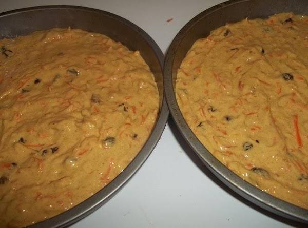 Pour evenly into the 2 cake pans. I plop them each once on the...