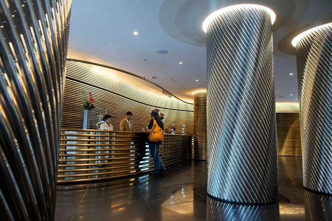The lobby features curved glamed-out metal everywhere. Photo: Al Drago/The New York Times