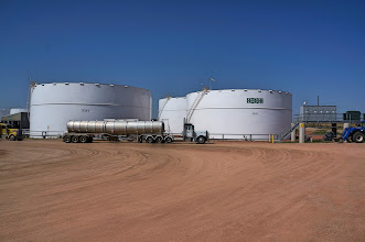 Photo: The white tanks hold crude oil after it is unloaded from trucks or pipeline, while it awats loading onto a train.