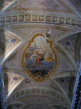 Photo: The flattened dome ceiling with gilt and frescoes decoration is typical of basilica-style construction.
