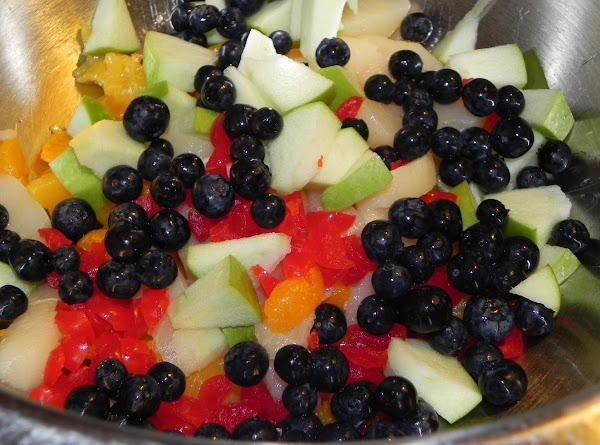 Combine fruits and nuts. [I sliced up the apples, peaches and pears into smaller...