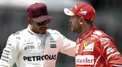 Lewis Hamilton and Sebastian Vettel on friendlier terms before the bust-up in Baku. Picture: MARK THOMPSON/ GETTY IMAGES