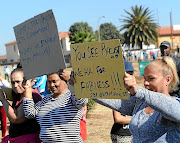 Klipspruit residents took to the streets  in protest against the appointment of  a black principal at a local  school. / Veli Nhlapo.