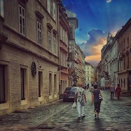 Sunset in Bratislava by Gene Brumer - City,  Street & Park  Street Scenes ( sky, bratislava, sunset, buildings, travel, people )