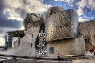 Photo: Lone musician outside Guggenheim Museum in Bilbao, Spain.