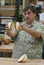 "Photo: Tim shows how the bowls were situated in the other log dropped off by the ""wood fairy""."
