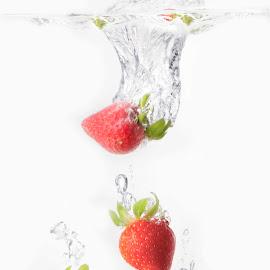 Strawberry splashes by Melissa Robertson - Food & Drink Fruits & Vegetables ( red, splashing, fruit, strawberry, strawberries, bubbles, water, splash water photography )