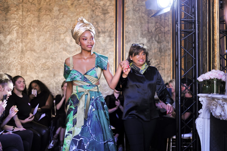 South African fashion designer and businesswoman Vanessa Gounden displays some creations from her African Rising collection at Paris Fashion Week.