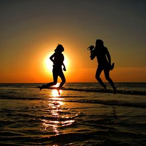 Jump by The Light by Wahyu Jr. Abadi - Landscapes Sunsets & Sunrises ( levitation, gililabak, sunset, silhouette, geghans, silhouettes, beach, sunrise, landscape, jump, surabaya,  )
