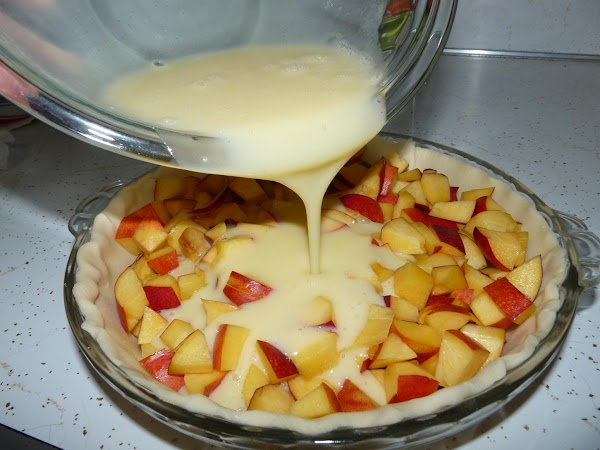 """Put the pie crust into a 9"""" pie plate. Spread the chopped nectarines in..."""