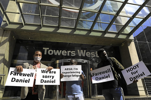 Supporters of Daniel Mminele express their feelings over his surprise departure from Absa. The bank has rejected suggestions that race was a factor. Picture: ALON SKUY