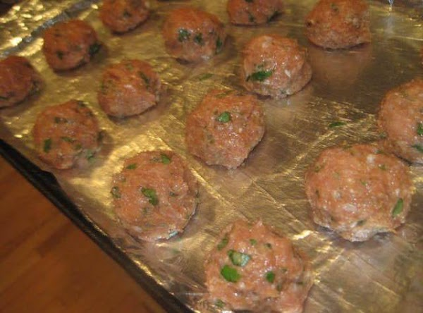 Form 15 to 16 1-1/2 inch meatballs and place on prepared baking sheet and...