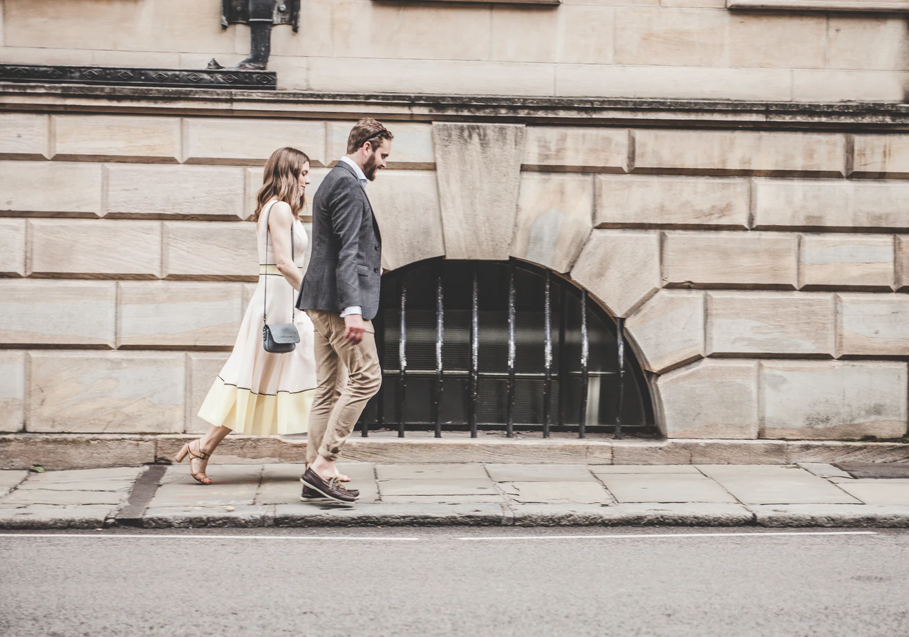 couple holding hands walking down the street