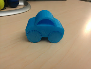 Photo: One piece car. The dam axles work (with a little prying/coaxing with an exacto knife)