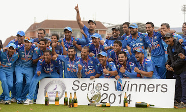 Photo: LEEDS, ENGLAND - SEPTEMBER 05:  India celebrate after winning the Royal London One Day International series between England and India at Headingley on September 5, 2014 in Leeds, England.  (Photo by Gareth Copley/Getty Images)