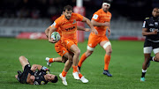 Louis Schreuder of the Cell C Sharks looks to tackle Ramiro Moyano of the Jaguares during the Super Rugby match between Cell C Sharks and Jaguares at Jonsson Kings Park on July 14, 2018 in Durban, South Africa.