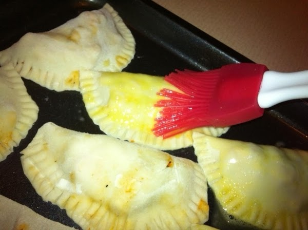 Place empanadas on a non-stick cookie sheet, brush with egg wash, and bake in...