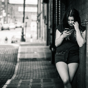 Phone home by Rob James - People Portraits of Women ( urban, phone, model, black and white, bridge, tunnel )