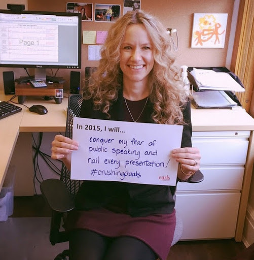 Managing Director of Design holding up her 2015 Vision + Goals: To Conquer her fear of public speaking.