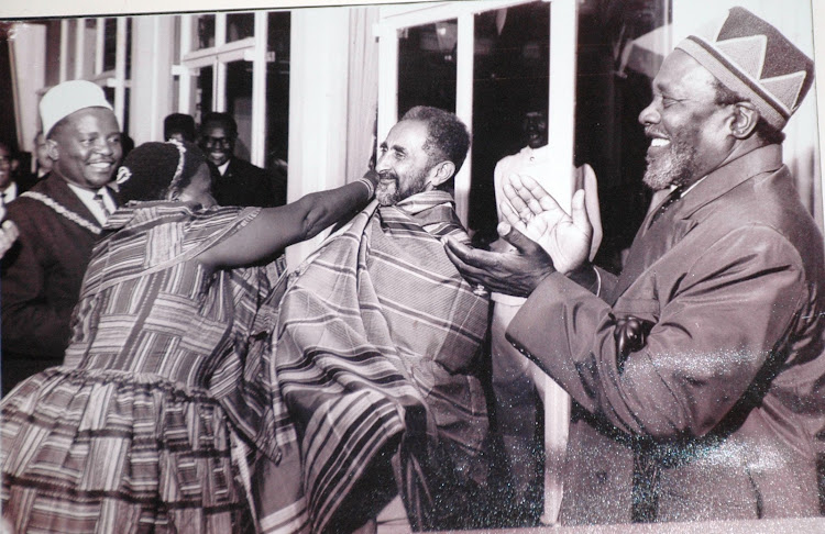 Former Emperor of Ethiopia Haile Selassie receives a gift from KANU women when he visited Kenya