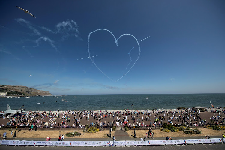 The Red Arrows Royal Air Force Aerobatic Team perform during an event to celebrate Armed Forces Day in Llandudno, Wales.
