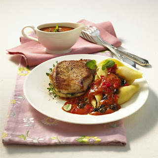 Pork Steak with Pasta in Tomato and Olive Sauce.