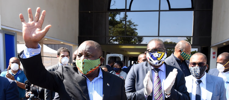 President Cyril Ramaphosa, accompanied by Gauteng premier David Makhura and Gauteng MEC for health Bandile Masuku, during a visit to a quarantine site.