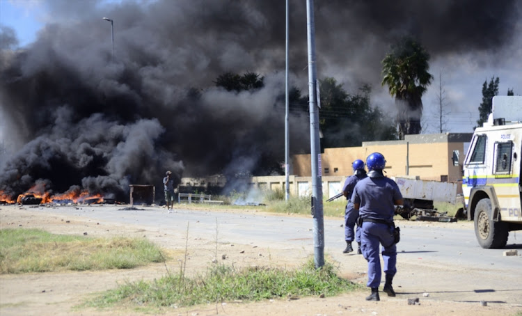 Police patrol the area during violent protests on April 19, 2018 in Mahikeng. File photo.