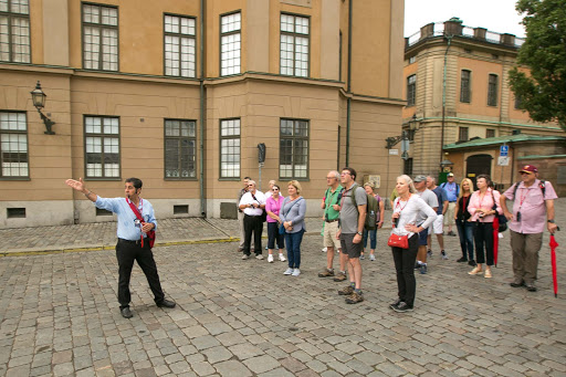 Tour-guide-in-Gamla-stan.jpg -   Gabriel Hultfred, a Viking tour guide, points to a landmark in Old Stockholm.