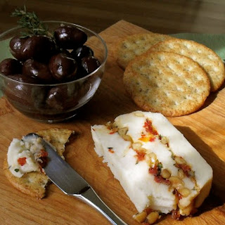 Cheddar Terrine with Sundried Tomatoes and Pine Nuts.