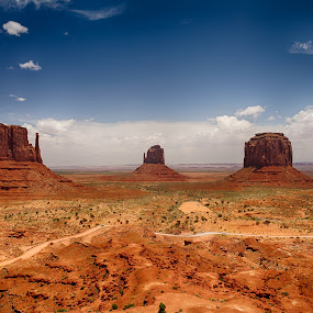 Monument Valley  by Jeannie Meyer - Landscapes Deserts ( clouds, navajo nation, navajo, monument valley, blue sky, utah, arizona, landscape, the mittens,  )