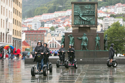 Segways-in-Bergen.jpg - Visitors tool around on Segways in the rain.