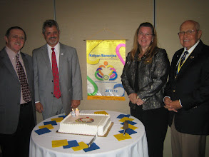 Photo: President Dennis Micare (2010-2011), Incoming President Rev. Dennis Robinson, District 6970 Governor Cynde Covington, and Acting (and Past President 2009-2010) President Blaine Timmer on June 10, 2011 at the Installation Banquet
