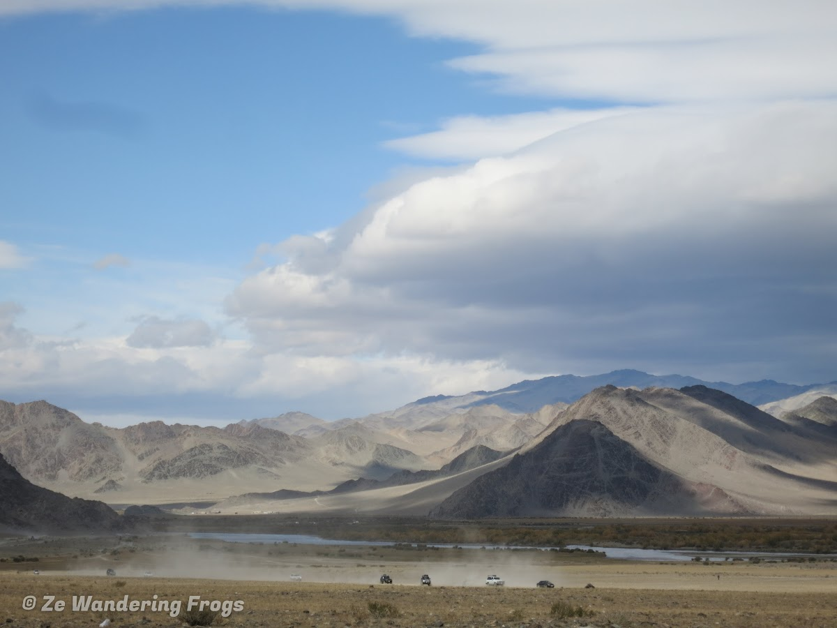 Mongolia. Golden Eagle Festival Olgii. View of the Golden Eagle Festival ground and surrounded Altai mountains
