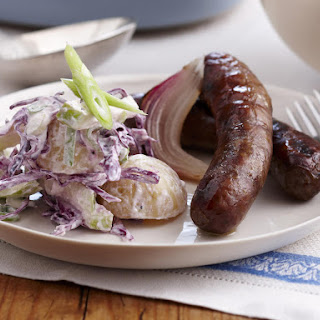 Baked Sausages with Potato–Cabbage Salad.